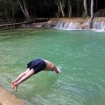 Diving into the waterfall pool