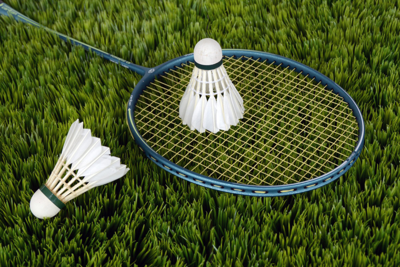 Badminton equipment on grass