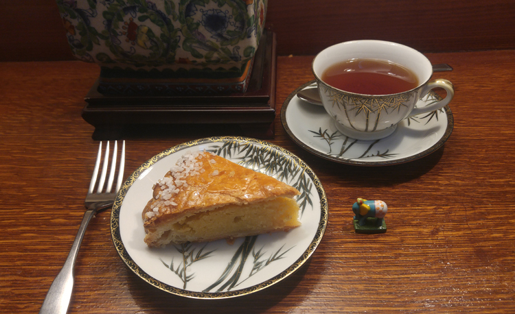 A slice of galette des rois and a cup of tea