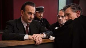 Deputy Prefect Servier (Cyril Couton) and Dr. Daniel Larcher (Robin Renucci) on trial after the war.