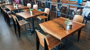 Check out the gorgeous, solid walnut tables in the PAE airport lounge