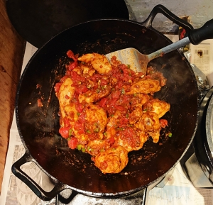 Karhai chicken with remaining spices tossed in