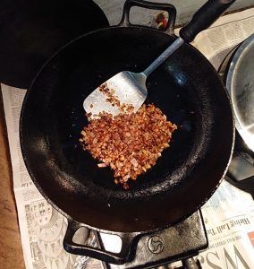 Properly fried onions in a cast iron karhai