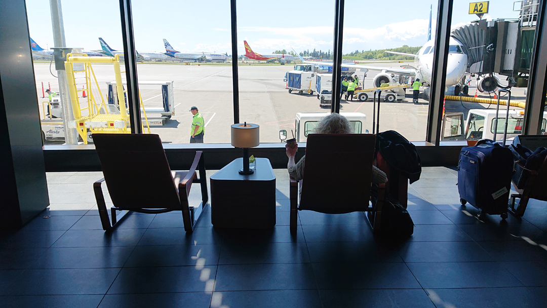 A woman relaxes waiting for her flight from PAE airport